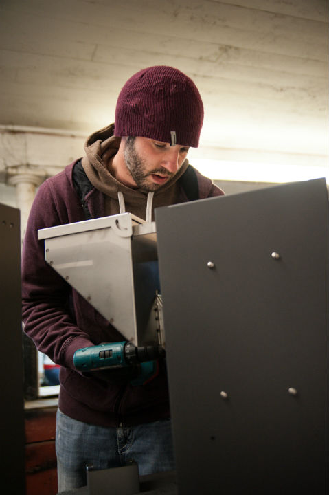 Tyson Traeger building a wood pellet outdoor heater