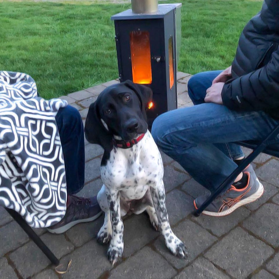 The Big Timber patio heater warming a family