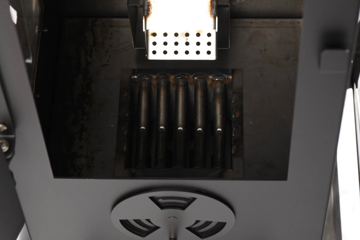 The Inner workings of a wood pellet patio heater.