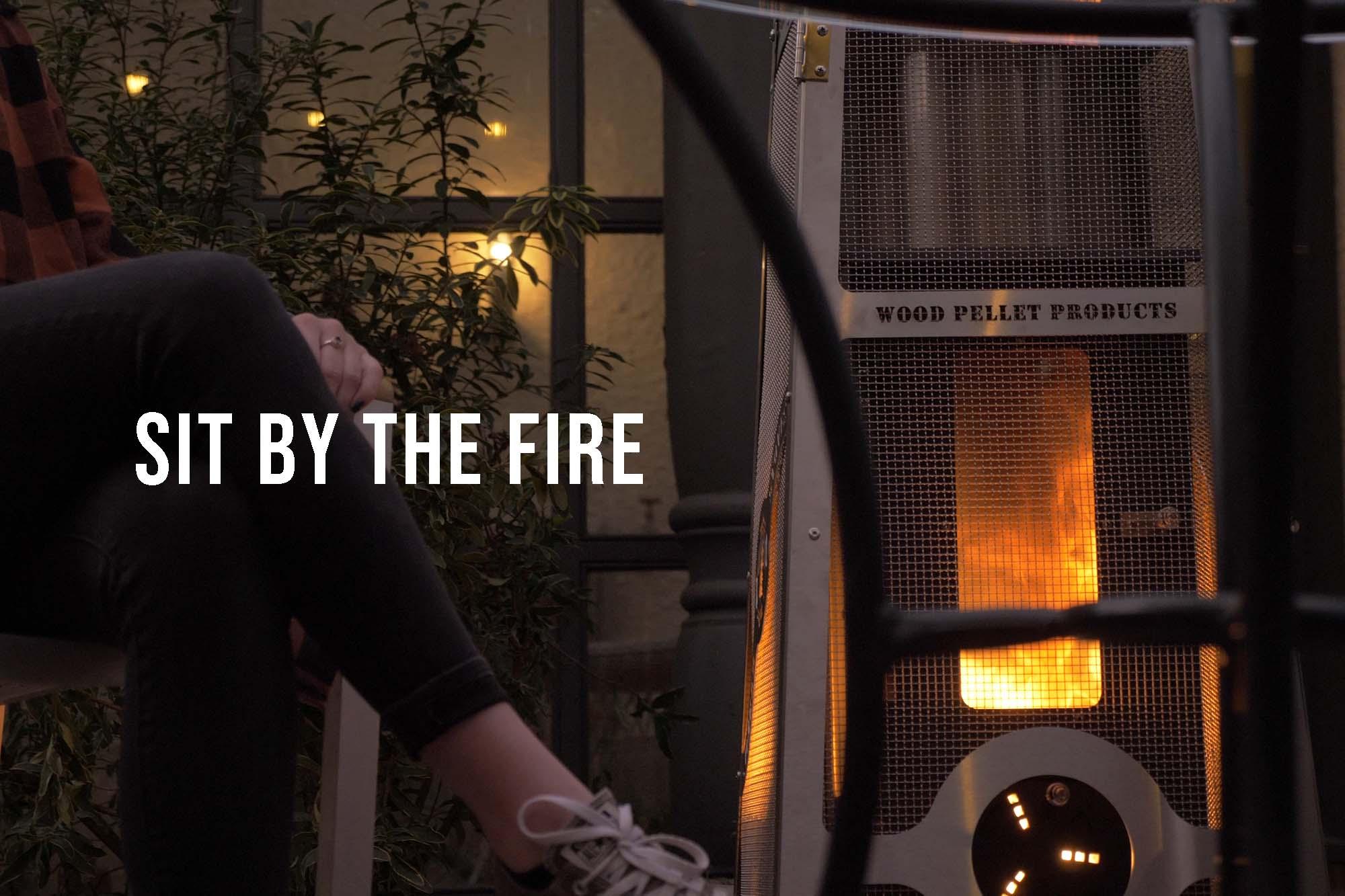 A wood pellet burning patio heater